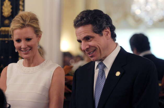 Sandra Lee, left, the governor's companion and Food Network star and Governor Andrew Cuomo greet visitors to the Executive Mansion on Sunday, Jan. 1, 2012 during an open house in Albany. (Paul Buckowski / Times Union)