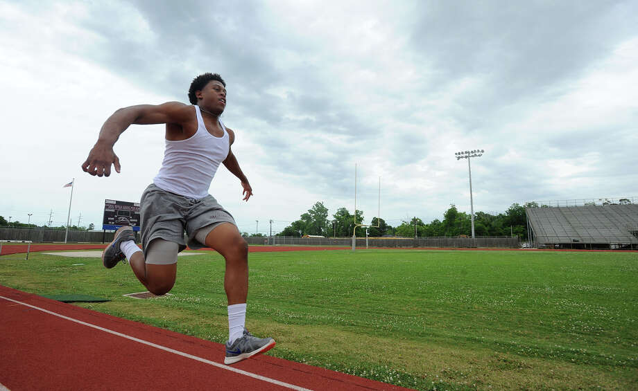 Central's Devwah Whaley practices the triple jump at Babe Zaharias stadium on Monday. Devwah will compete at the UIL State Track and Field Meet this weekend.  Photo taken Monday, May 11, 2015  Guiseppe Barranco/The Enterprise Photo: Guiseppe Barranco, Photo Editor