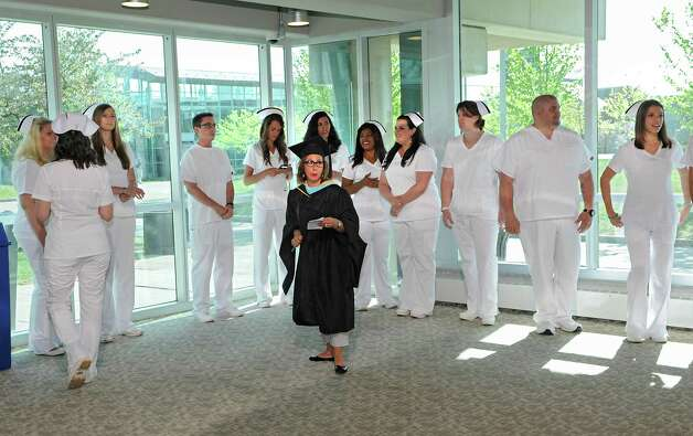 Albany Memorial School of Nursing graduates line up for their commencement in the lobby of the Maureen Stapleton Theater at Hudson Valley Community College on Monday, May 11, 2015 in Troy, N.Y. The program is part of Albany Memorial Hospital and St. Peter's Health Partners. (Lori Van Buren / Times Union) Photo: Lori Van Buren / 00031500A