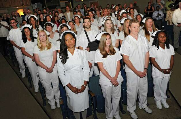 Albany Memorial School of Nursing graduates stand at the beginning of their commencement in the Maureen Stapleton Theater at Hudson Valley Community College on Monday, May 11, 2015 in Troy, N.Y. The program is part of Albany Memorial Hospital and St. Peter's Health Partners. (Lori Van Buren / Times Union) Photo: Lori Van Buren / 00031500A