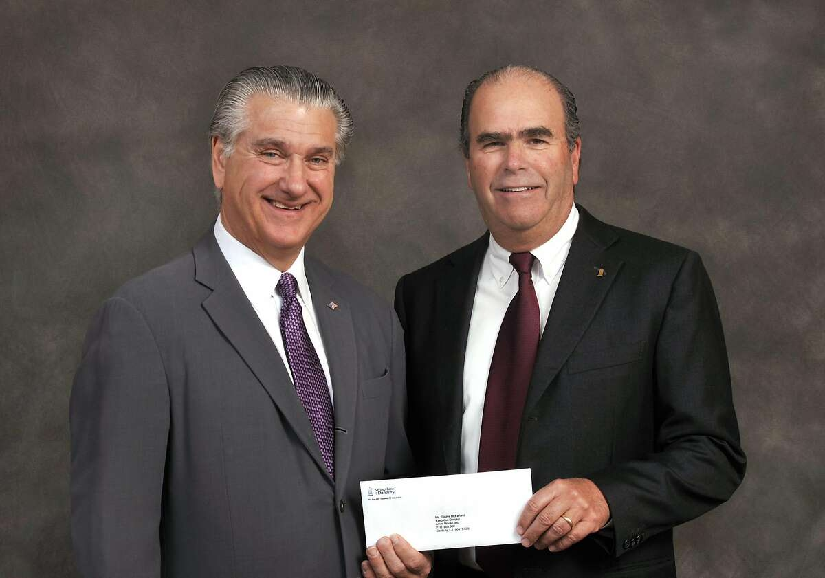 Joe Walkovich, President of the Amos House Board of Directors receives a $2,500 grant from Gary Hawley, Chairman of the Savings Bank of Danbury Board of Directors. April, 2012 at Danbury, Conn.
