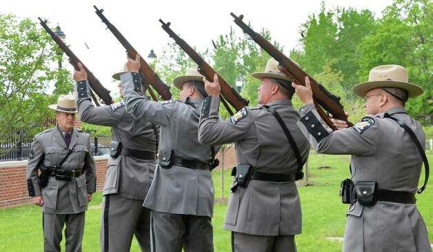 The Troop G rifle team fires a salute during a State Police memorial service for fallen members of Troop G Tuesday May 12, 2015 in Colonie, NY.  (John Carl D'Annibale / Times Union) Photo: John Carl D'Annibale / 00031803A