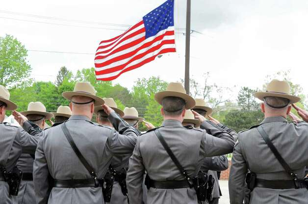 Troopers snap to attention during a State Police memorial service for fallen members of Troop G Tuesday May 12, 2015 in Colonie, NY.  (John Carl D'Annibale / Times Union) Photo: John Carl D'Annibale / 00031803A