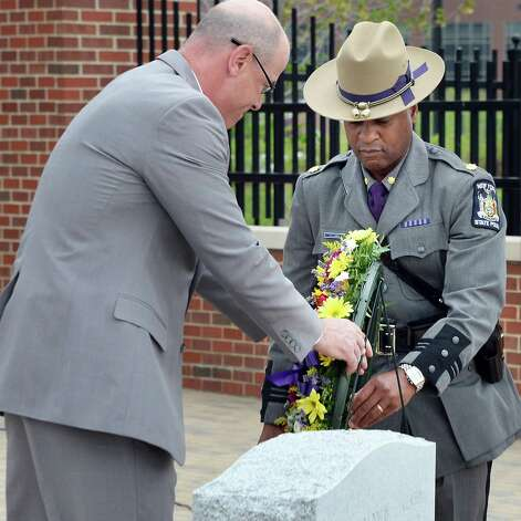 First Deputy Superintendent Kevin Gagnon, left and Major Steven James lay a wreath during a State Police memorial service for fallen members of Troop G Tuesday May 12, 2015 in Colonie, NY.  (John Carl D'Annibale / Times Union) Photo: John Carl D'Annibale / 00031803A