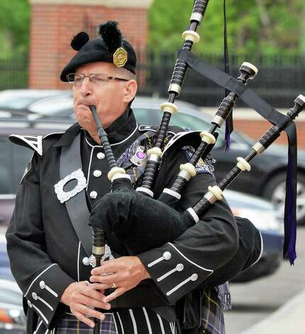 Piper and State Police Investigator Thomas Malone plays during a State Police memorial service for fallen members of Troop G Tuesday May 12, 2015 in Colonie, NY.  (John Carl D'Annibale / Times Union) Photo: John Carl D'Annibale / 00031803A