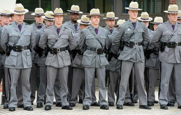 Troopers stand during a State Police memorial service for fallen members of Troop G Tuesday May 12, 2015 in Colonie, NY.  (John Carl D'Annibale / Times Union) Photo: John Carl D'Annibale / 00031803A