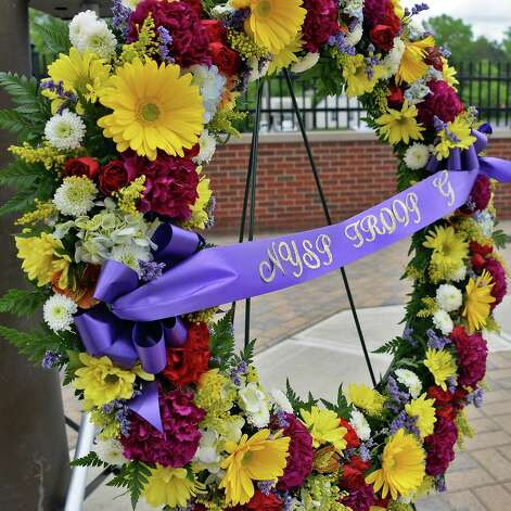 A flowered wreath during a State Police memorial service for fallen members of Troop G Tuesday May 12, 2015 in Colonie, NY.  (John Carl D'Annibale / Times Union) Photo: John Carl D'Annibale / 00031803A