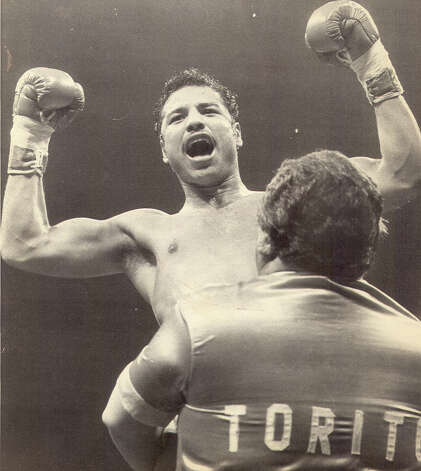 Tony Ayala Jr. is lifted up by his father Tony Ayala Sr. after a 1982 fight. Photo: San Antonio Express-News File Ph