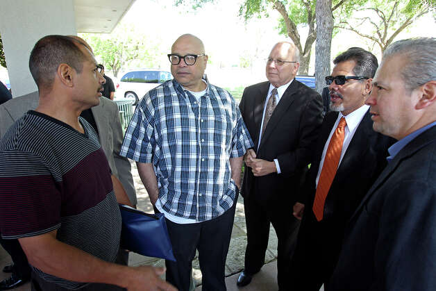 Paulie Ayala (left) talks with Tony, Jr. and Mike Ayala (second from right ) as Tony Ayala Sr. is remembered at funeral services at Palm Heights Mortuary and Ft. Sam Houston National Cemetery on April 16, 2014. Photo: TOM REEL