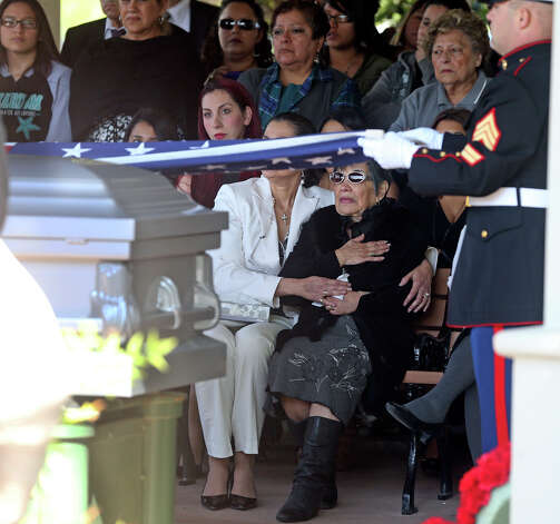 The widow Pauline Ayala salutes during ceremonies as Tony Ayala Sr. is remembered at funeral services at Palm Heights Mortuary and Ft. Sam Houston National Cemetery on April 16, 2014. Photo: TOM REEL