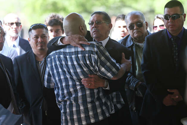 Tony Ayala, Jr. is consoled by supporters as Tony Ayala Sr. is remembered at funeral services at Palm Heights Mortuary and Ft. Sam Houston National Cemetery on April 16, 2014. Photo: TOM REEL