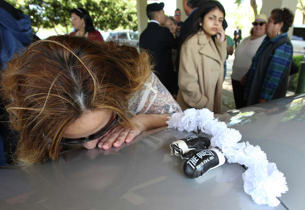 Supporters pay last respects by kissing the coffin as Tony Ayala Sr. is remembered at funeral services at Palm Heights Mortuary and Ft. Sam Houston National Cemetery on April 16, 2014. Photo: TOM REEL