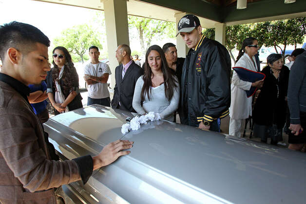 Mourners pay their sat respect as Tony Ayala Sr. is remembered at funeral services at Palm Heights Mortuary and Ft. Sam Houston National Cemetery on April 16, 2014. Photo: TOM REEL
