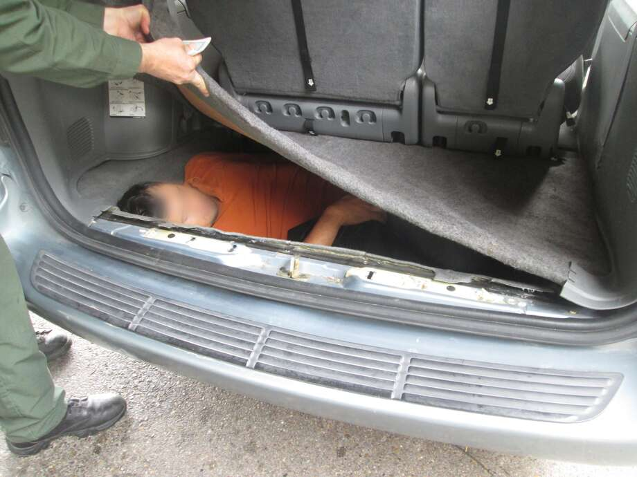 The past weekend was a busy one for Rio Grande Valley Border Patrol Agents with four separate incidents leading to the apprehension of 18 people hidden in vehicle compartments and their drivers as well as a two felons. Photo: U.S. Customs And Border Protection