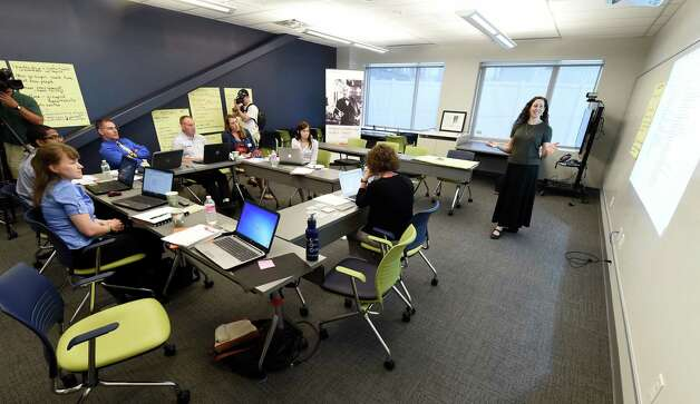 J. Lana Hower, Tech Valley High School social studies teacher and certified New Tech Network trainer, speaks to a group of visiting teachers from the Delaware Military Academy during a class in the new GE Collaboration Lab Tuesday morning May 12, 2015 at the Tech Valley Hi in Albany, N.Y.        (Skip Dickstein/Times Union) Photo: SKIP DICKSTEIN / 00031799A