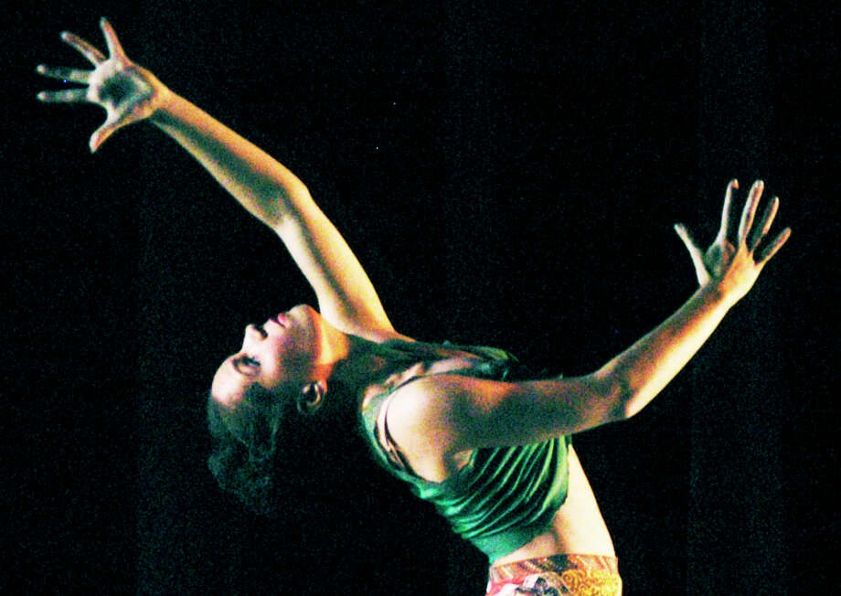 """Kayla Burton captures the audience's rapt attention with her dance performance to """"Feelin' Good""""  during FineLine Theatre Arts' 2015 Dance Fest, May 3, 2015 at Shepaug Valley School in Washington. Photo: Norm Cummings / The News-Times"""