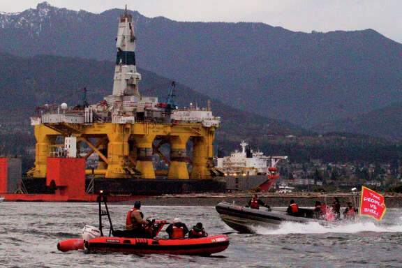 Greenpeace boats meet the arrival of Shell's massive Arctic drill rig as it enters the harbor at Port Angeles, Wash on April 17.