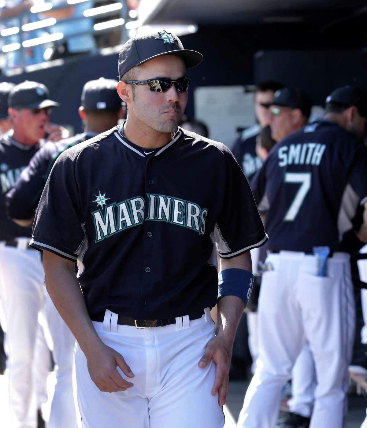 Seattle Mariners' Jesus Montero walks through the dugout before a spring training baseball game against the San Diego Padres Thursday, March 5, 2015, in Peoria, Ariz.