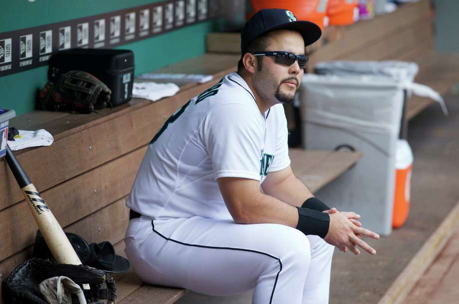 Seattle Mariners' Jesus Montero sits in the dugout before a baseball game against the San Diego Padres in Seattle, Tuesday, June 17, 2014. Photo: Stephen Brashear, AP / AP2014