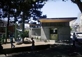 The new bathroom building in Washington Square Park with shingled concrete wall and a cantilevered roof with wood trim is seen on Friday, May 8, 2015 in San Francisco, Calif.