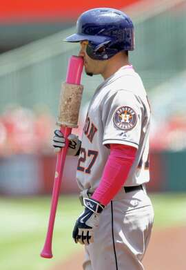 Houston Astros' Jose Altuve smells his pink bat while on deck during the first inning of a baseball game against the Los Angeles Angels in Anaheim, Calif., Sunday, May 10, 2015. (AP Photo/Alex Gallardo)