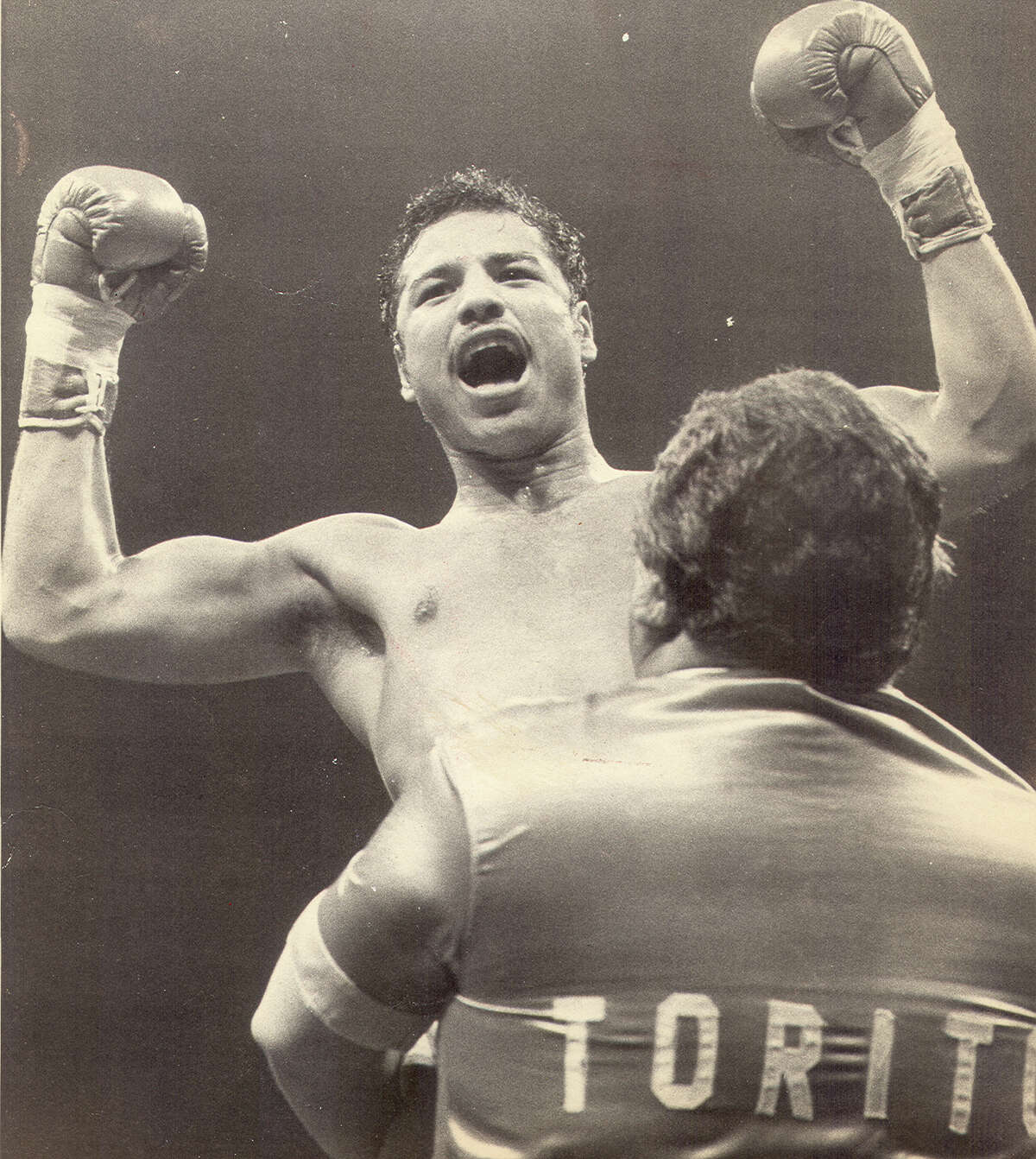 Tony Ayala Jr. is lifted up by his father Tony Ayala Sr. after a 1982 fight.
