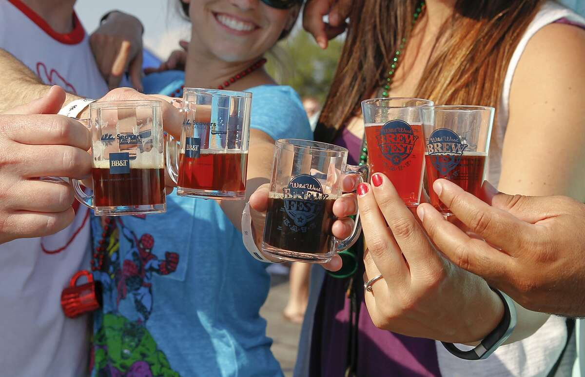 Beer lovers show off their craft beer samples at the Wild West Brewfest held at Katy Mills mall. Beer lovers show off their craft beer samples at the Wild West Brewfest held at Katy Mills mall.