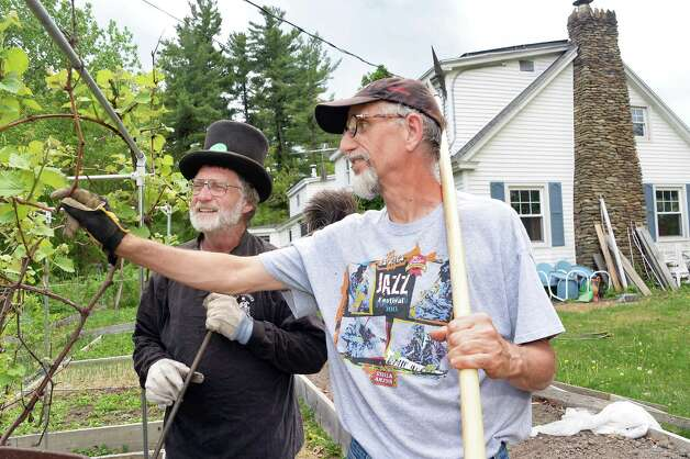"After finishing in the chimney,  sweep Peter Looker, left, gets a tour of Tim Owens' backyard ""farm"" Tuesday May 12, 2015 in Niskayuna, NY.  (John Carl D'Annibale / Times Union) Photo: John Carl D'Annibale"