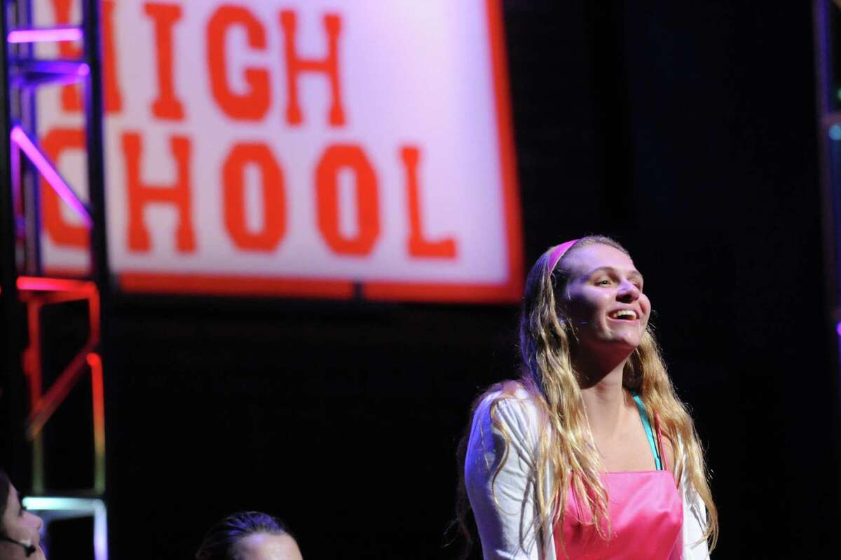 Patty Kohn, 17, a senior, performs as Sandy during the Greenwich High School Theater Arts dress rehearsal for the spring musical