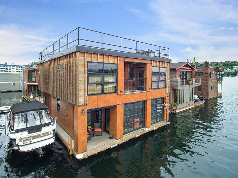 This floating home is located at 2369 Fairview Ave. E.  on Lake Union. The two bedroom, two-and-one-quarter bathroom home is listed for $2.595 million. 