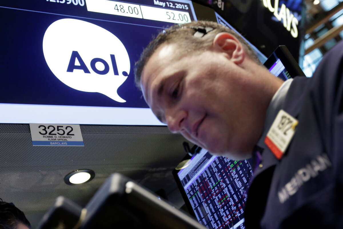 Trader Jonathan Corpina works at the post that handles AOL at the New York Stock Exchange after the Verizon deal was announced.
