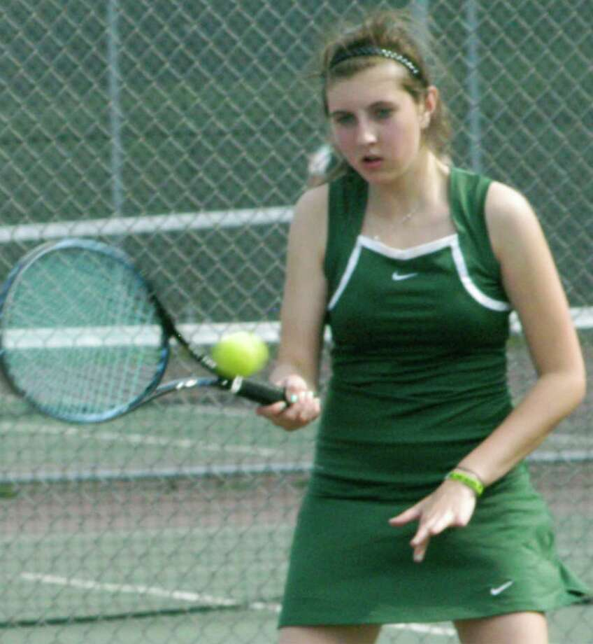 Amanda Aguayo, for three seasons the top singles player for the Green Wave, winds down her NMHS tennis career this week. May 2015 Photo: Norm Cummings / The News-Times