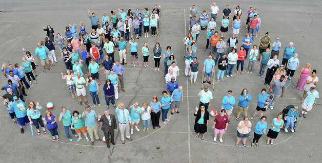 ARC of Rensselaer County celebrates their 65th Anniversary with a giant number 65 photo shoot Tuesday May 12, 2015 in Troy, NY.  (John Carl D'Annibale / Times Union) Photo: John Carl D'Annibale / 00031743A