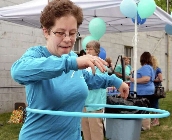 ARC client Danielle Stacy plays with a hula hoop during a celebration of ARC of Rensselaer County's 65th Anniversary Tuesday May 12, 2015 in Troy, NY.  (John Carl D'Annibale / Times Union) Photo: John Carl D'Annibale / 00031743A