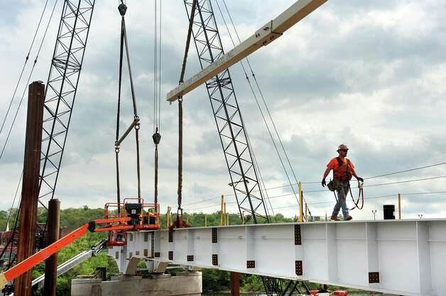 Iron worker Ryan Kelly of D.A. Collins Construction Co. works on the Mohawk Valley Gateway Overlook Pedestrian Bridge on Tuesday, May 12, 2015, in Amsterdam, N.Y. The $16.5 million project will help support the city's economy by connecting the south side's neighborhoods and Erie Canalway Trail with Riverlink Park and downtown Amsterdam on the north side. (Cindy Schultz / Times Union) Photo: Cindy Schultz / 00031781A