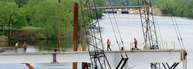 Construction continues on the Mohawk Valley Gateway Overlook Pedestrian Bridge on Tuesday, May 12, 2015, in Amsterdam, N.Y. The $16.5 million project will help support the city's economy by connecting the south side's neighborhoods and Erie Canalway Trail with Riverlink Park and downtown Amsterdam on the north side. (Cindy Schultz / Times Union) Photo: Cindy Schultz / 00031781A