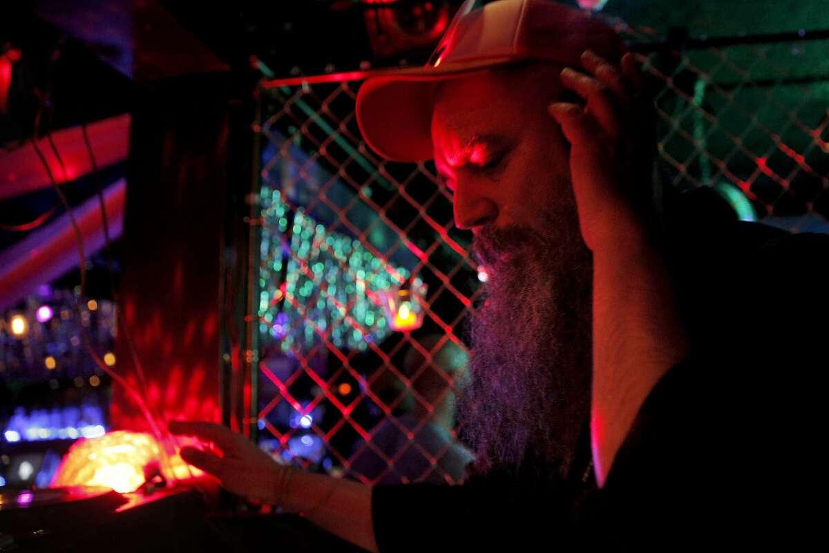 DJ Bus Station John mixes for his party,