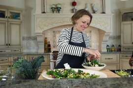 Melissa Perello, chef owner of S.F. restaurants Frances and Octavia, makes kale salad, Monday, March 16, 2015, in Burlingame, Calif.