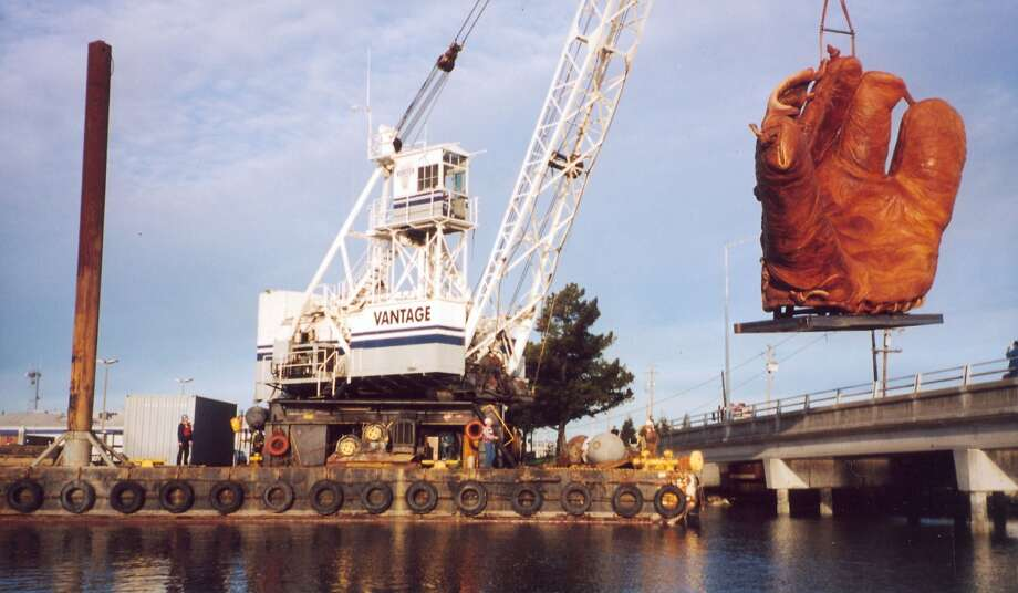 The giant four-fingered glove being dropped into place at AT&T Park before it opened in 2000. Photo: Ron Holthuysen, Scientific Art Studio