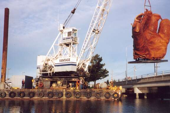 The giant four-fingered glove being dropped into place at AT&T Park before it opened in 2000.