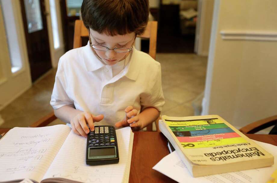 Eric Comstock, 9, is shown at his home Monday, May 11, 2015, in Conroe. Eric began college classes at age 8 and just won the Lone Star College system Calculus 1 contest. Photo: Melissa Phillip, Houston Chronicle / © 2015  Houston Chronicle