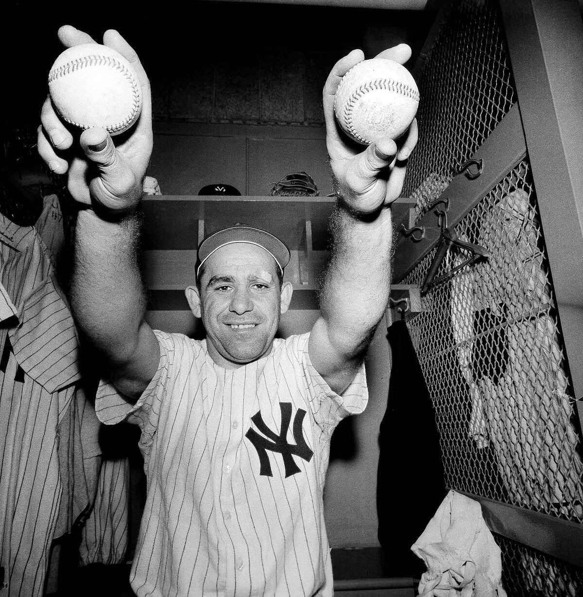 This Aug. 20, 1959 file photo shows New York Yankee Yogi Berra as he talked about the two home runs he hit in the 7-1 victory over Cleveland in a game in New York. The great Yogi Berra turns 90 on May 12, 2015. (AP Photo/Ray Howard, File)