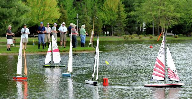 Members of the Capital Area Model Boat Assoc. sail their remote-control sailboats in a regatta on Tuesday, May 12, 2015, at The Crossings in Colonie, N.Y. The group meets every Tuesday and Thursday afternoon though mid-October to compete with their boats on the pond. (Cindy Schultz / Times Union) Photo: Cindy Schultz