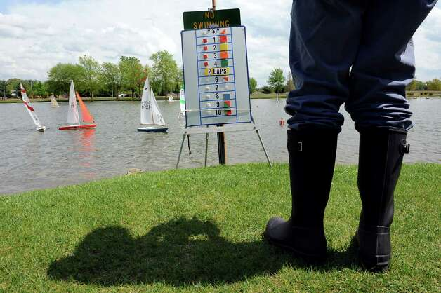 Richard Piasecki of Loudenville stands by the regatta course board as he remotely controls his sailboat on Tuesday, May 12, 2015, at The Crossings in Colonie, N.Y. The Capital Area Model Boat Assoc. meets every Tuesday and Thursday afternoon though mid-October to compete with their boats on the pond. (Cindy Schultz / Times Union) Photo: Cindy Schultz