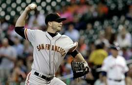 San Francisco Giants' Chris Heston delivers a pitch against the Houston Astros in the first inning of a baseball game Tuesday, May 12, 2015, in Houston. (AP Photo/Pat Sullivan)