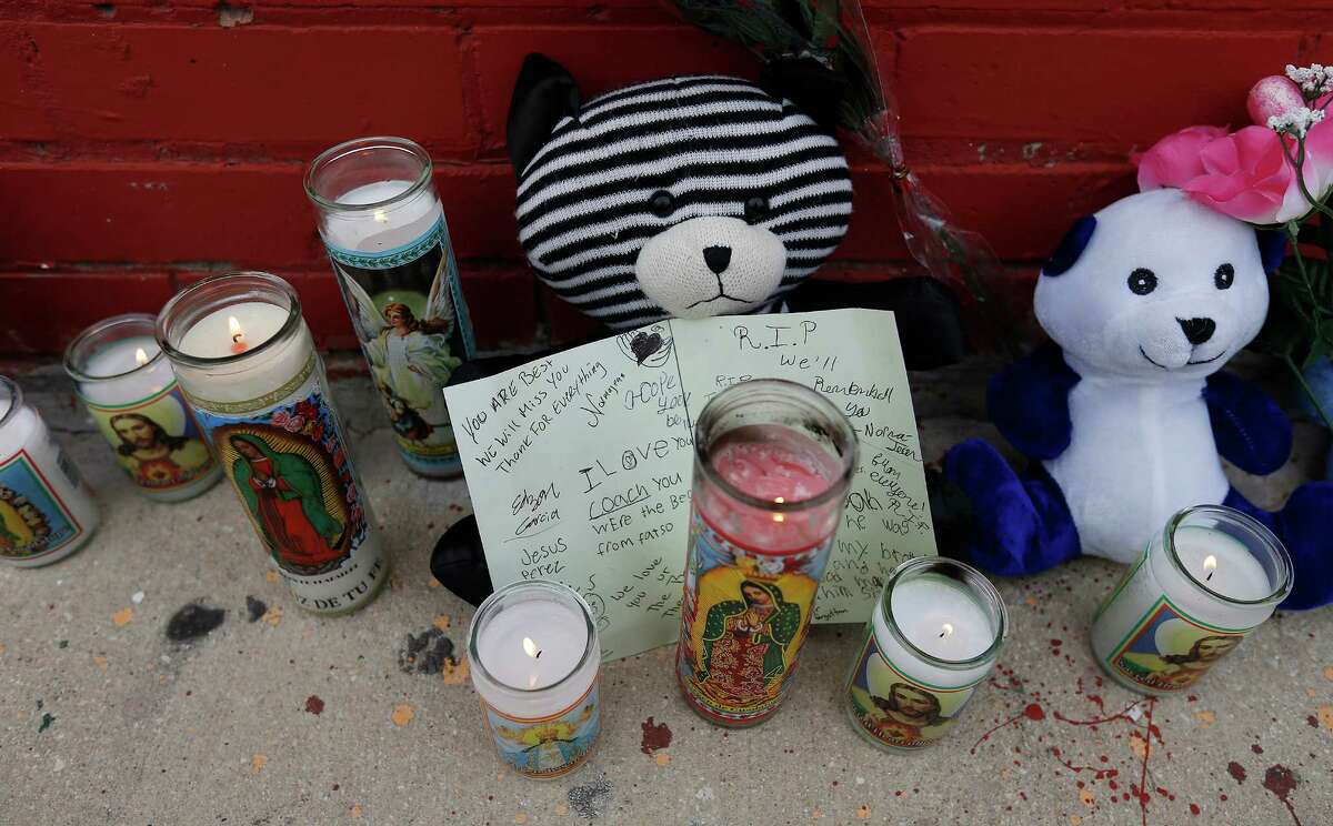 Candles, stuffed toy bears and a card are among the items left to remember the passing of local boxing legend Tony Ayala Jr. at Zarzamora Street Gym on Tuesday, May 12, 2015. News spread of Ayala's passing throughout the regulars who trained at the gym that Ayala and his father, Tony Ayala Sr. started in the 1980s. The 52-year-old former boxer was found dead in the gym.