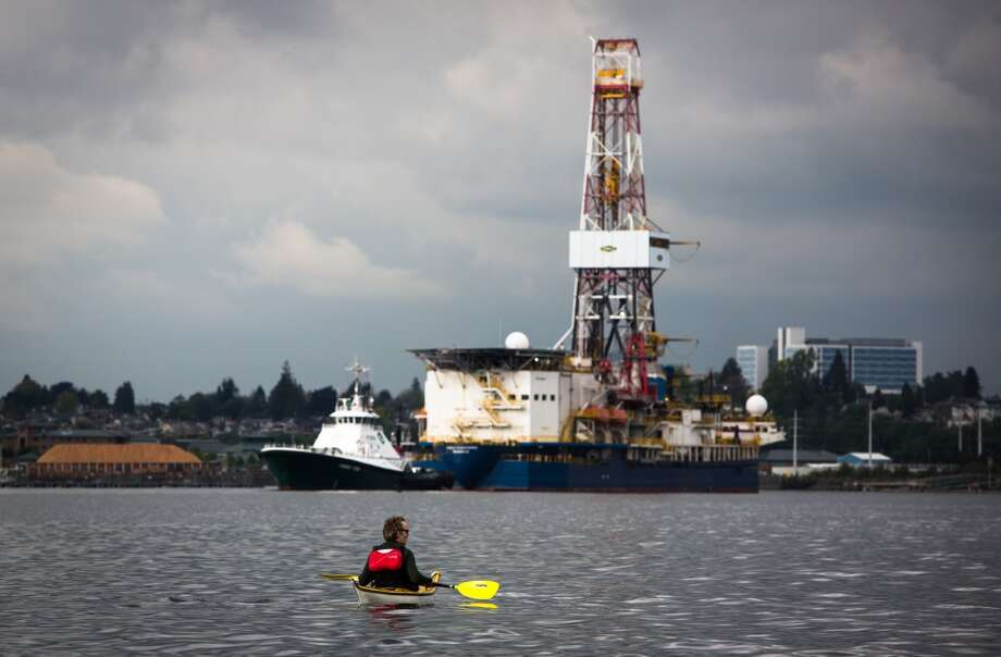 "Jordan Van Voast watches Shell's Arctic drilling vessel the Noble Discoverer arrive in Everett on Tuesday, May 12, 2015. Van Voast and other ""kayaktivists"" from Shell No paddled out to protest the arrival of the rig. The rig arrived just as the Port of Seattle voted to delay the arrival of Shell's Polar Pioneer drill rig in Seattle. Photo: DANIELLA BECCARIA, SEATTLEPI.COM"