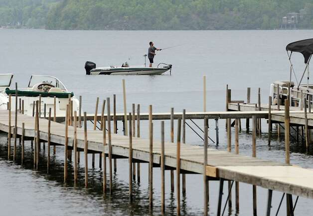 A fisherman casts his line as rain falls gently on Saratoga Lake Tuesday, May 12, 2015 in Saratoga Springs, N.Y. (Lori Van Buren / Times Union) Photo: Lori Van Buren