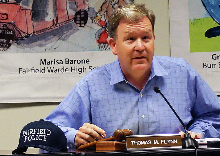 Board of Finance Chairman Thomas Flynn passed out baseball caps to fellow board members Tuesday to signal their support of the Fairfield Police Department. Photo: Genevieve Reilly / Fairfield Citizen