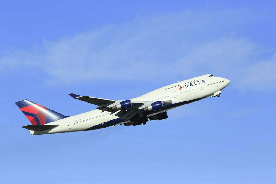 A Delta Airlines flight had to make a quick, unscheduled return to Sea-Tac Airport Thursday night after passenger attacked a flight attendant on the Beijing-bound flight. A Delta 747 is pictured above in a file photo. Photo: Getty Images / Universal Images Group Editorial